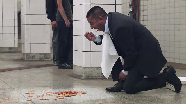 picture of This Brand Manager Trusts His Product Enough To Eat Food Off A Crowded Subway Platform