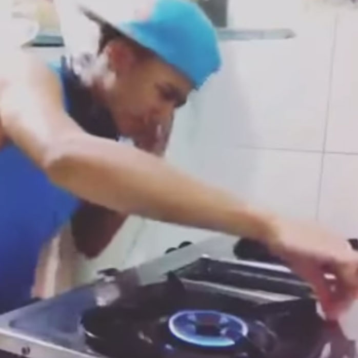 picture of DJ Kalan has gone viral because of his video that DJing using a stove